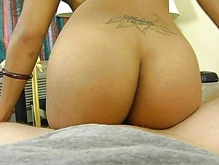 Hot ebony babe with a tattoo sucking a cock