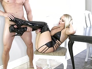 Sexy blonde shows off her latex boots before giving handjob