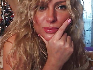 Blonde with beautiful curly hair shows herself on camera