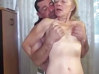 Slutty granny with saggy tits is riding a rock hard dick, like a pro whore