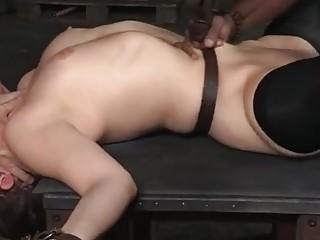 Rough bondage sex overwhelms a slutty brunette