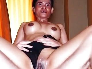 Amateur Thai mature masseur Amee riding on a big white cock