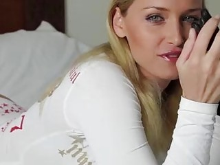 Beautiful blonde mistress is wearing leather gloves while giving a sensual handjob to her lover