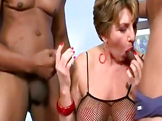 Busty Mature Gets Two Bbcs