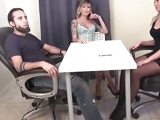 Sexy office lady is giving a footjob to a new co- worker, from under the table